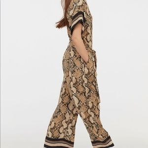 H&M jumpsuit. Beige snakeskin pattern size 2